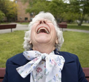 Senior Woman Laughing --- Image by © Steve Prezant/Corbis